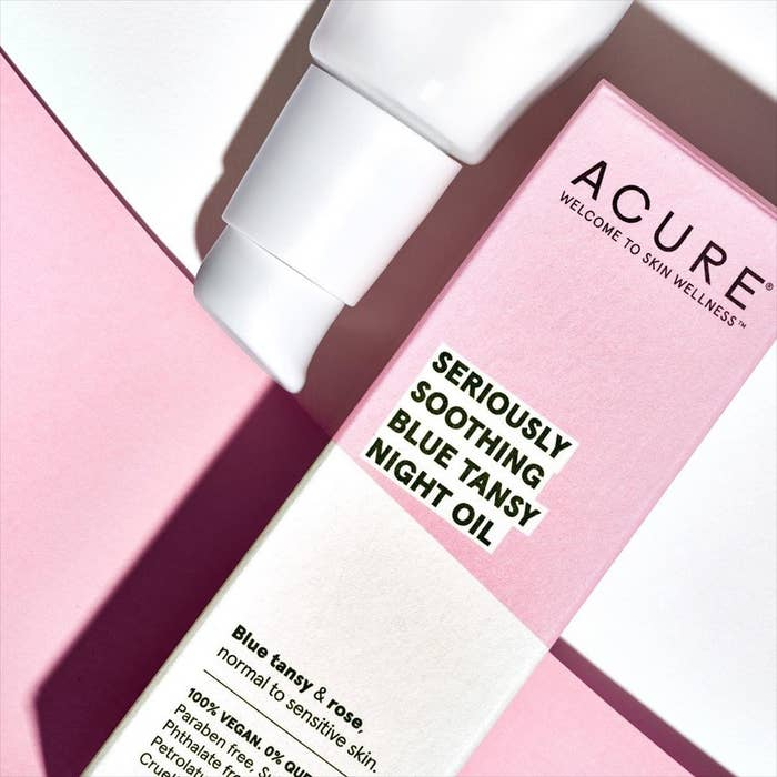 """Pink and white box that says """"Acure Seriously Soothing Blue Tansy Night Oil"""""""
