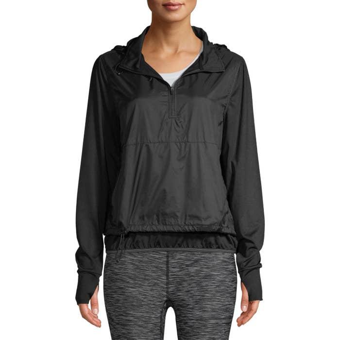 Model wearing the black windbreaker pullover
