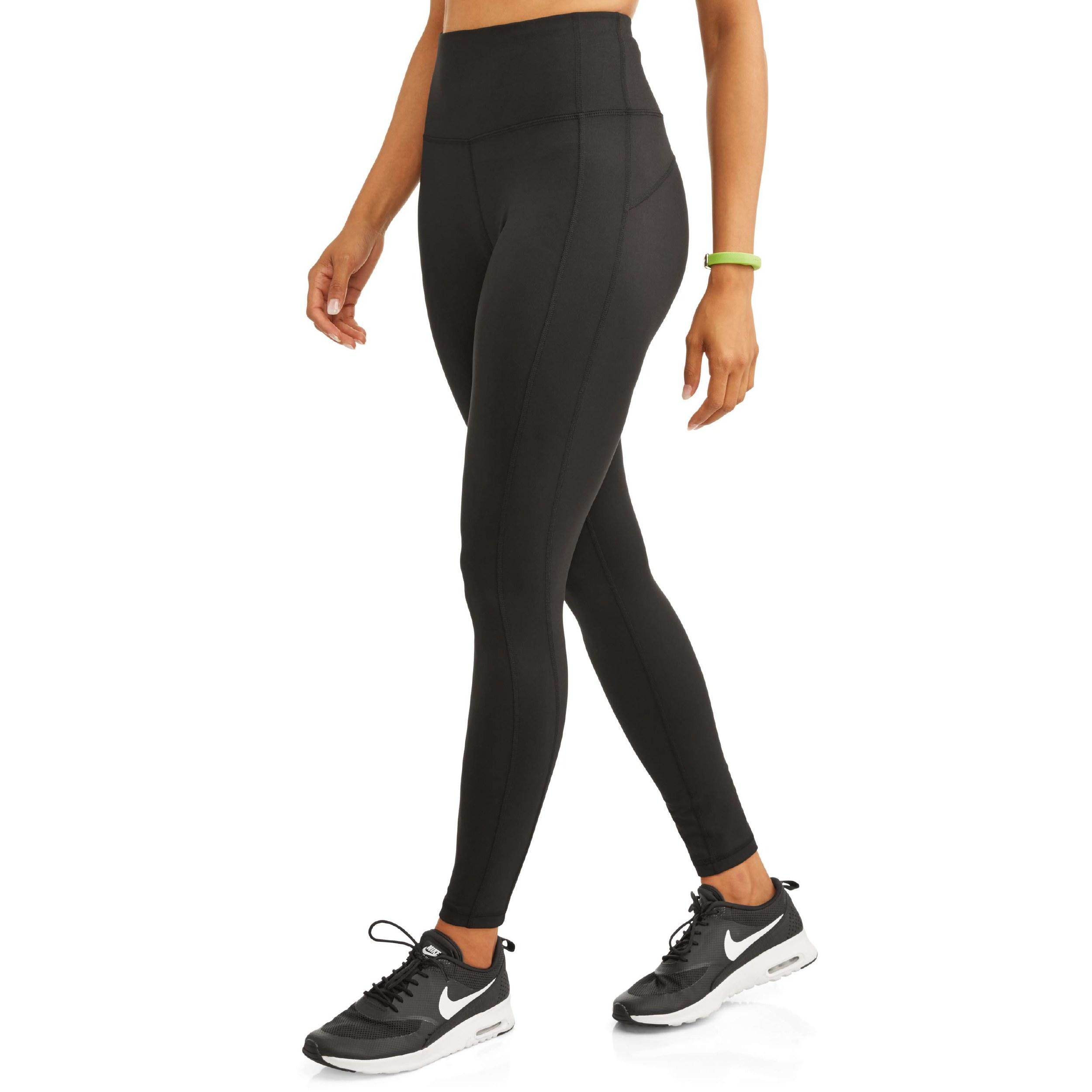Model wearing the black shiny leggings