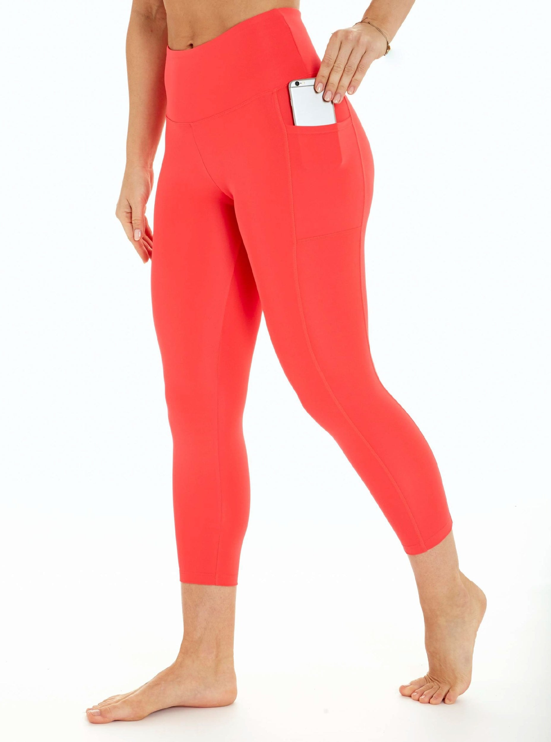 Model wearing the bright red leggings