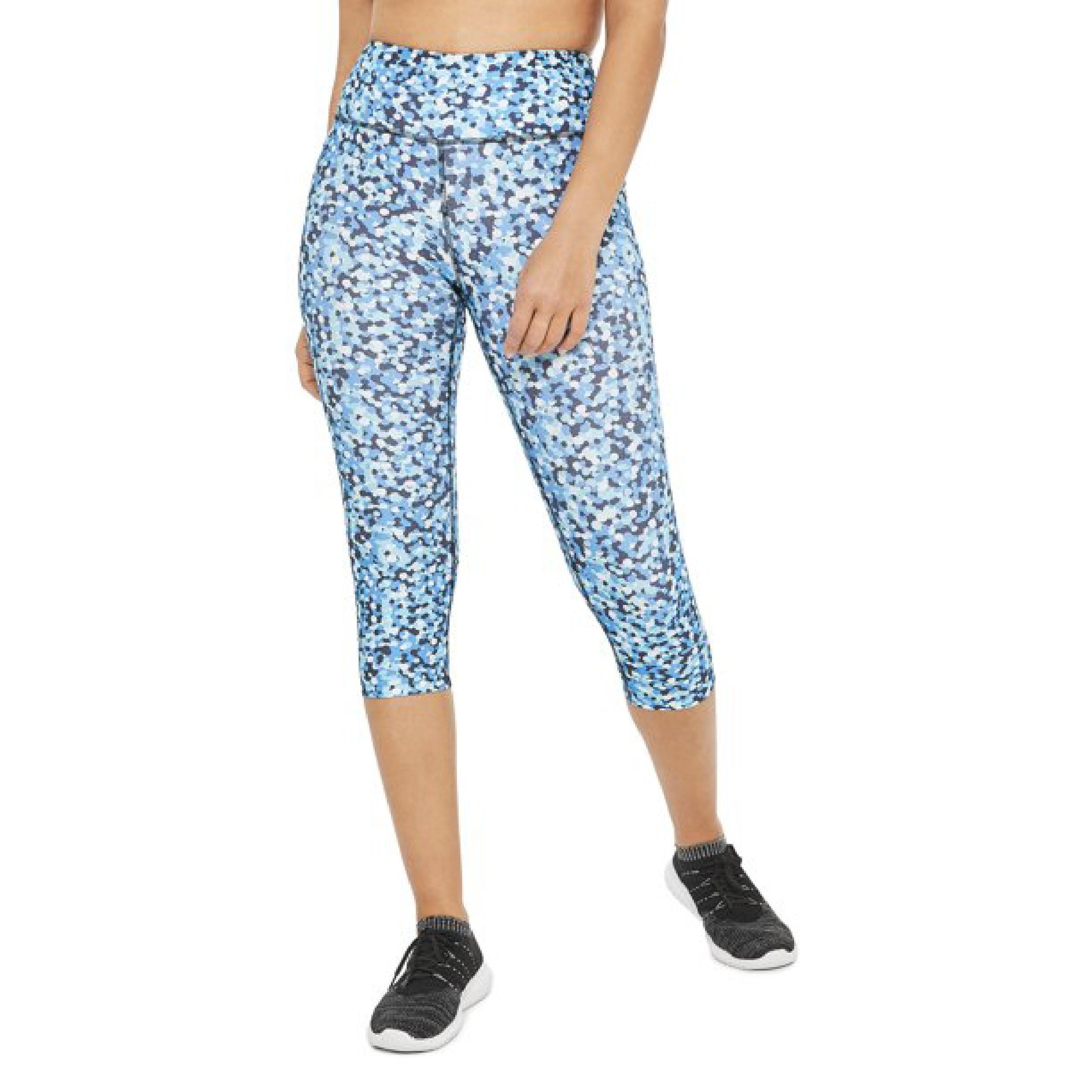 Model wearing the blue patterned capri leggings