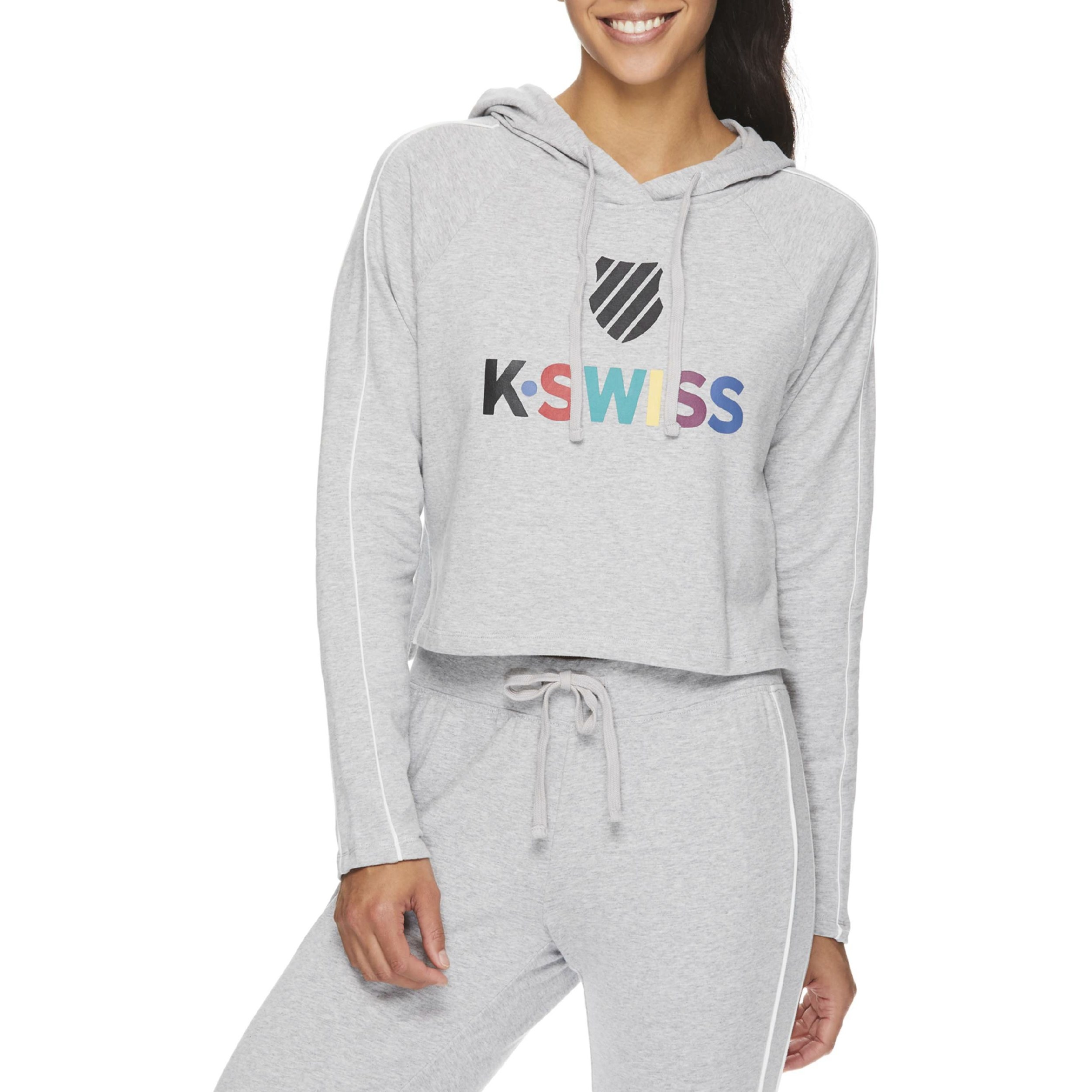 "Model wearing the grey cropped sweatshirt with the word ""K Swiss"" in rainbow letters on the chest"