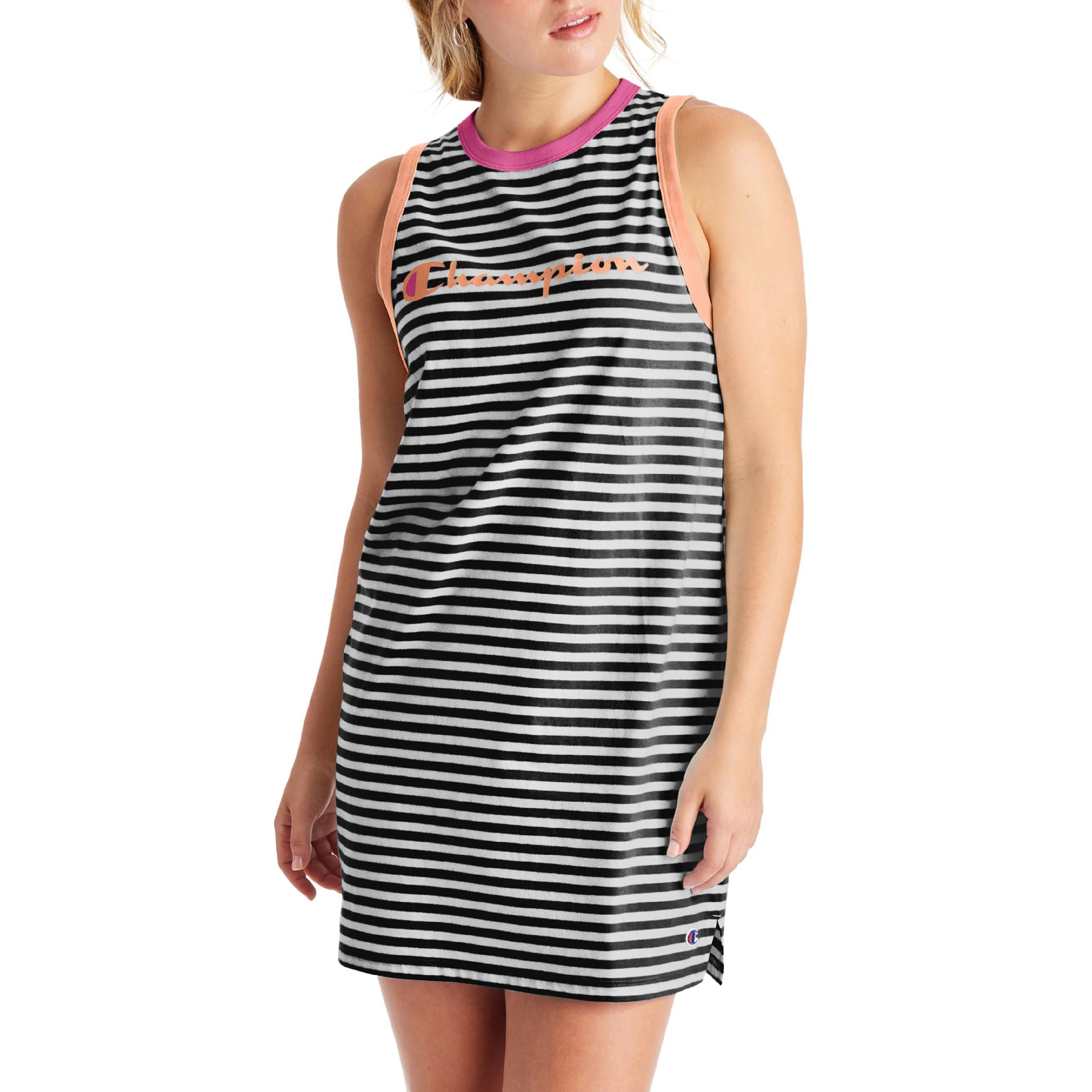 "Model wearing the black and white striped tank dress with the word ""Champion"" on the chest"