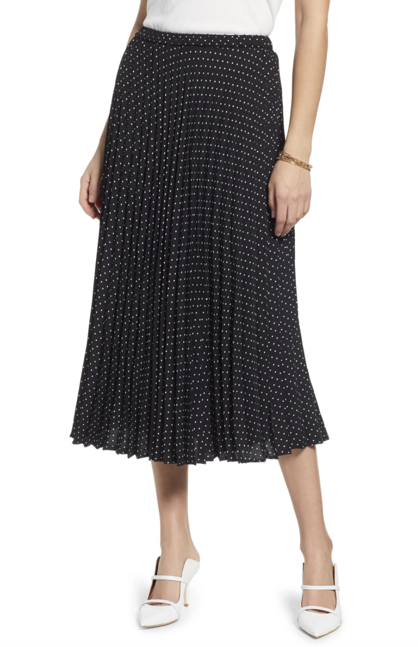 Model wearing the skirt in black with small white polka dots