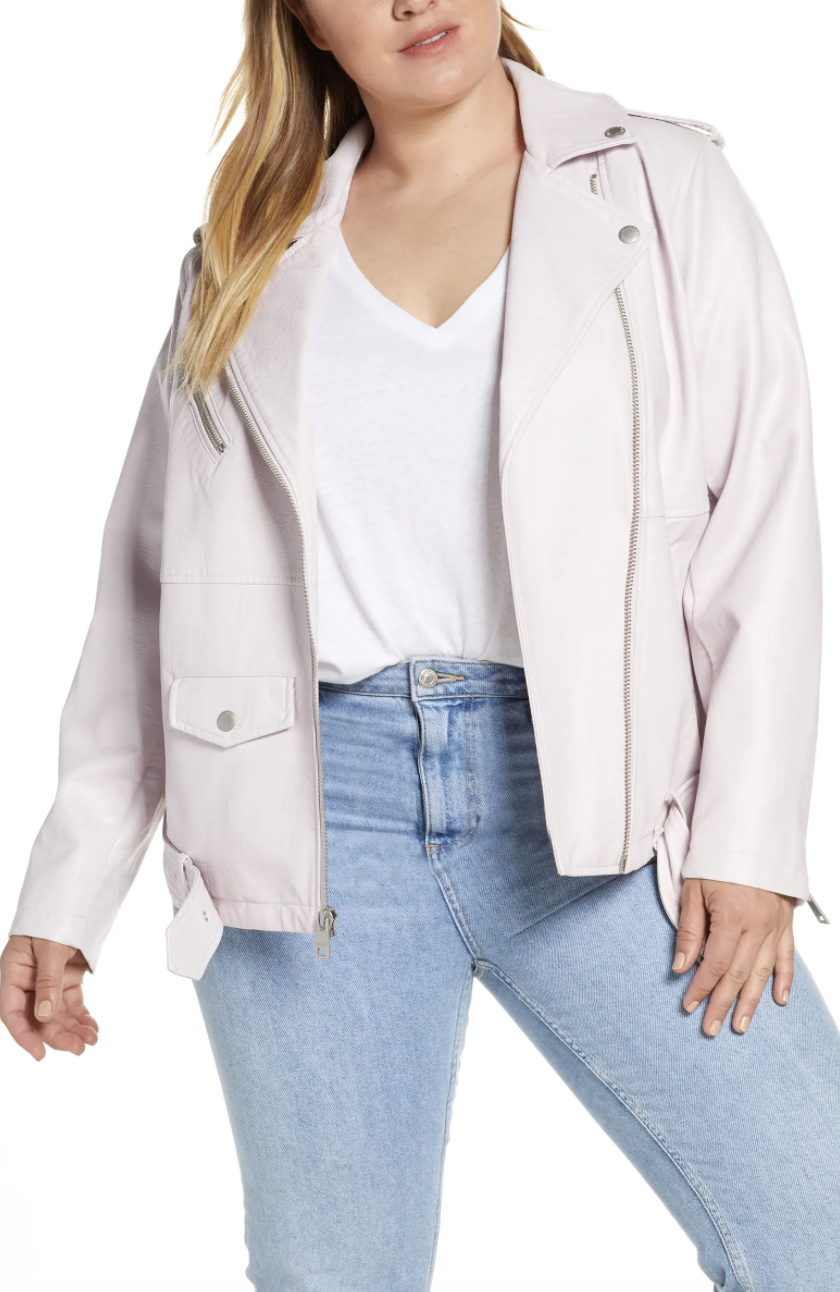 The oversize faux leather moto jacket with snap-down lapels, zippers, and a belted waist in blush