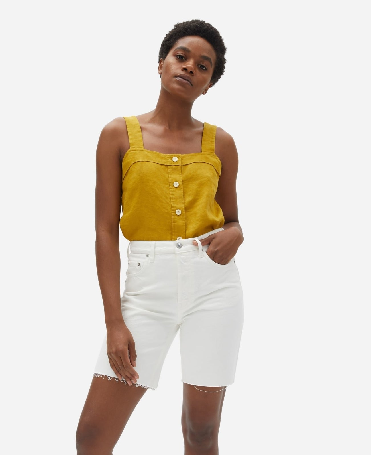 model in yellow tank with wide straps and buttons up the middle