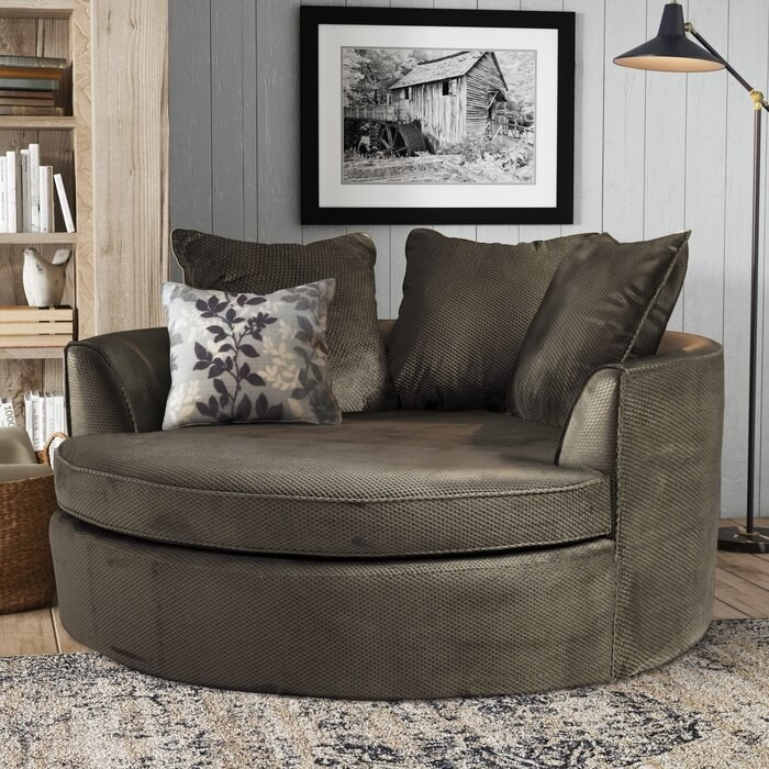 Round barrel chair in grey upholstery