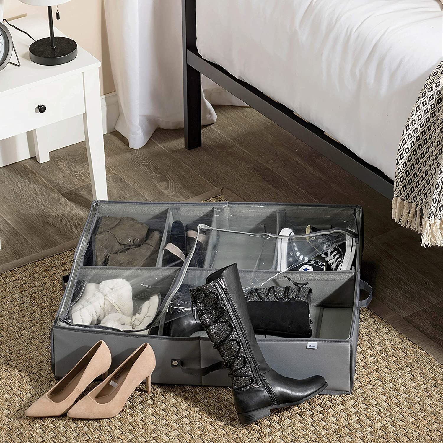 A large fabric container on the floor filled with shoes