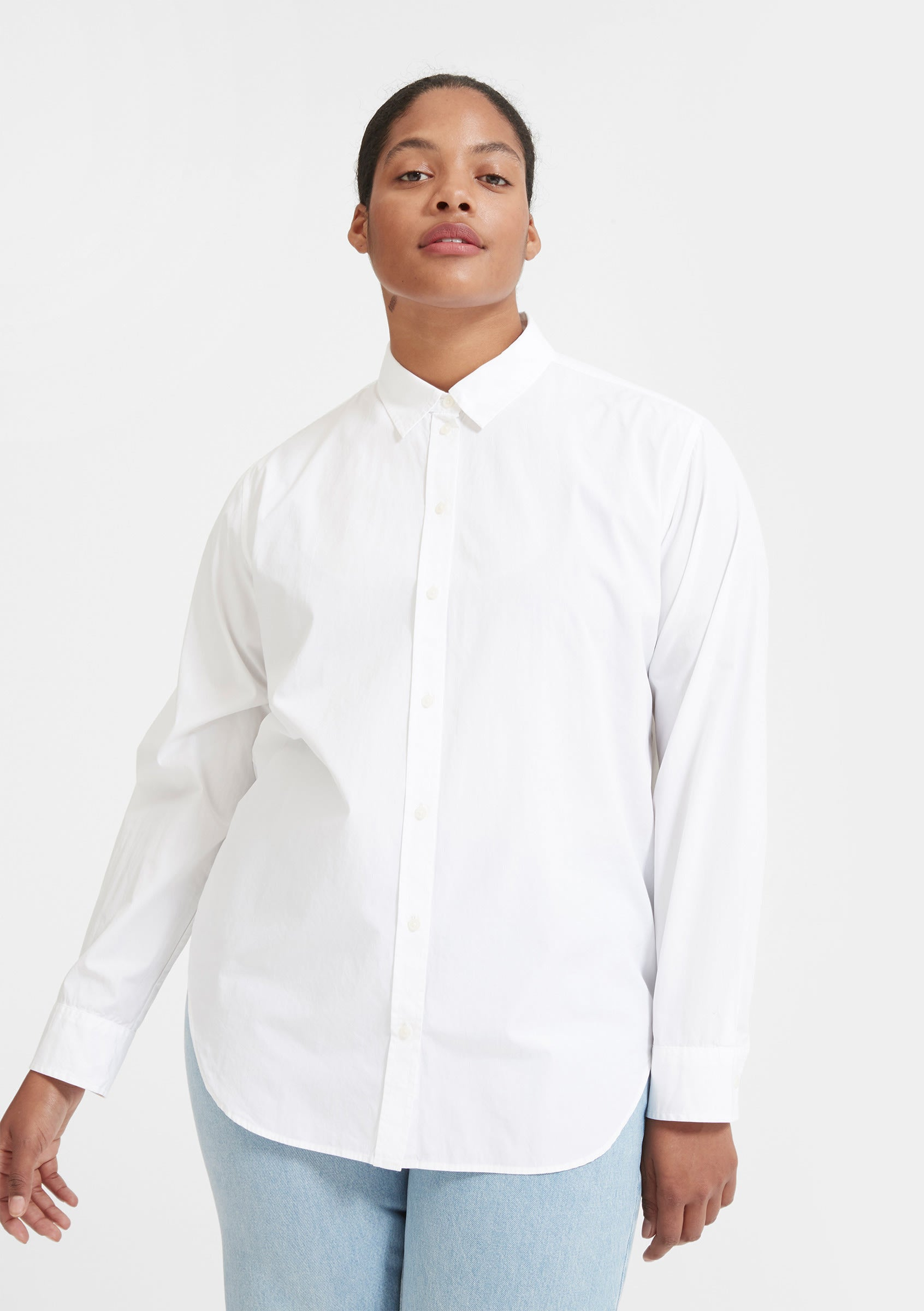 model in white long-sleeve button-up