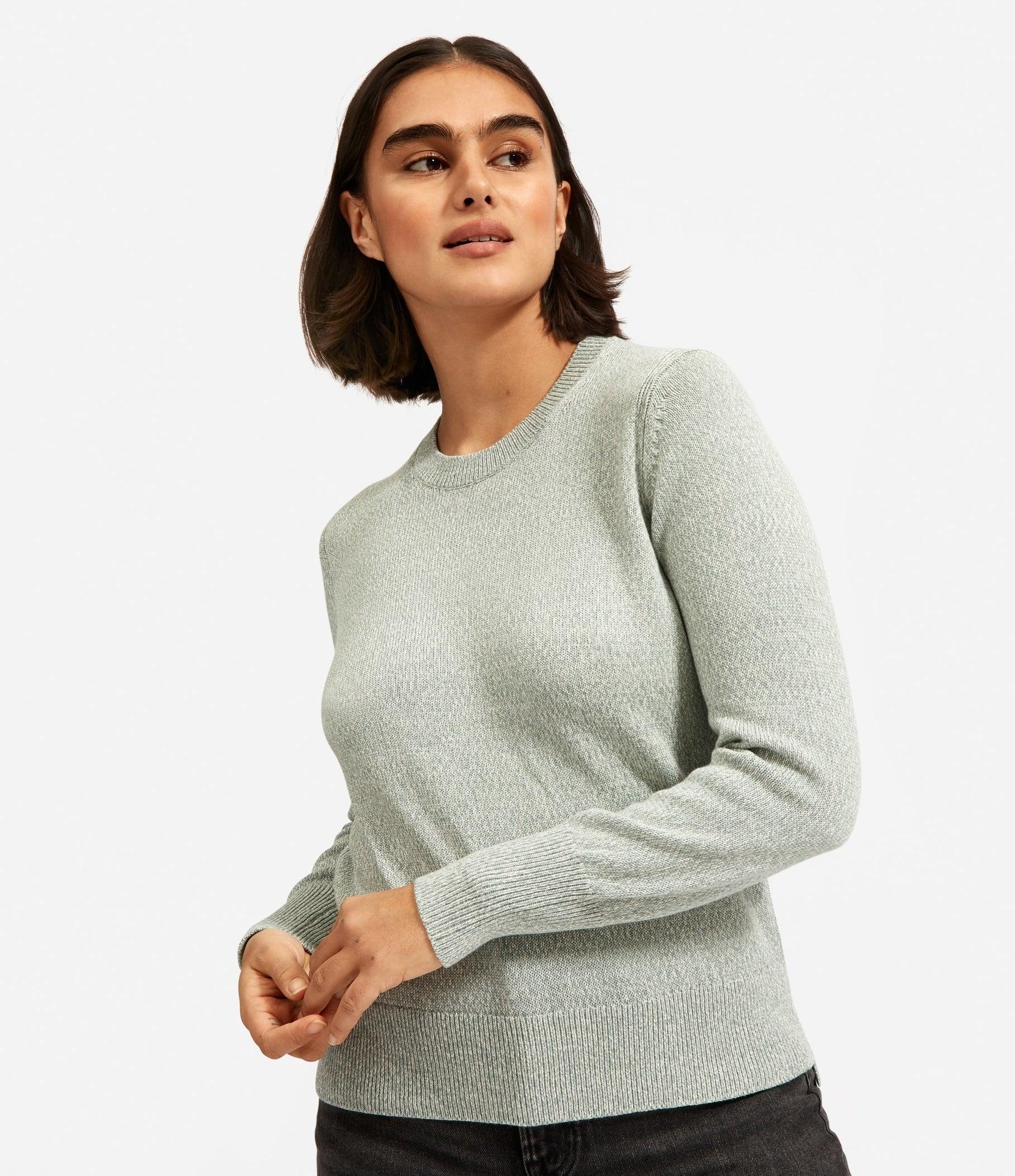 model in light green crew sweater