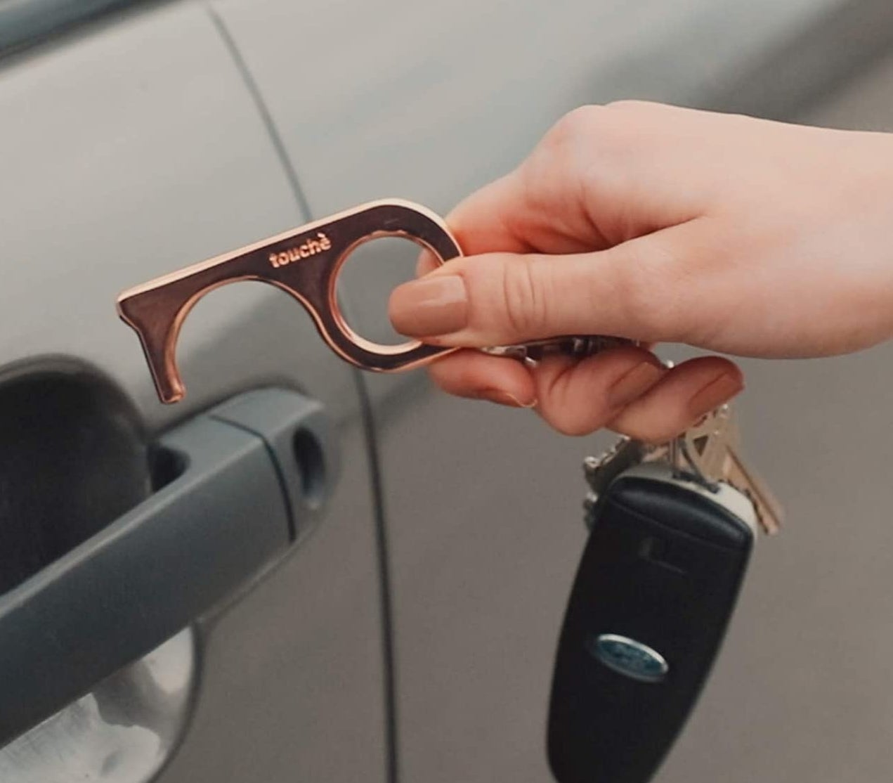 A person using the tool to open their care door