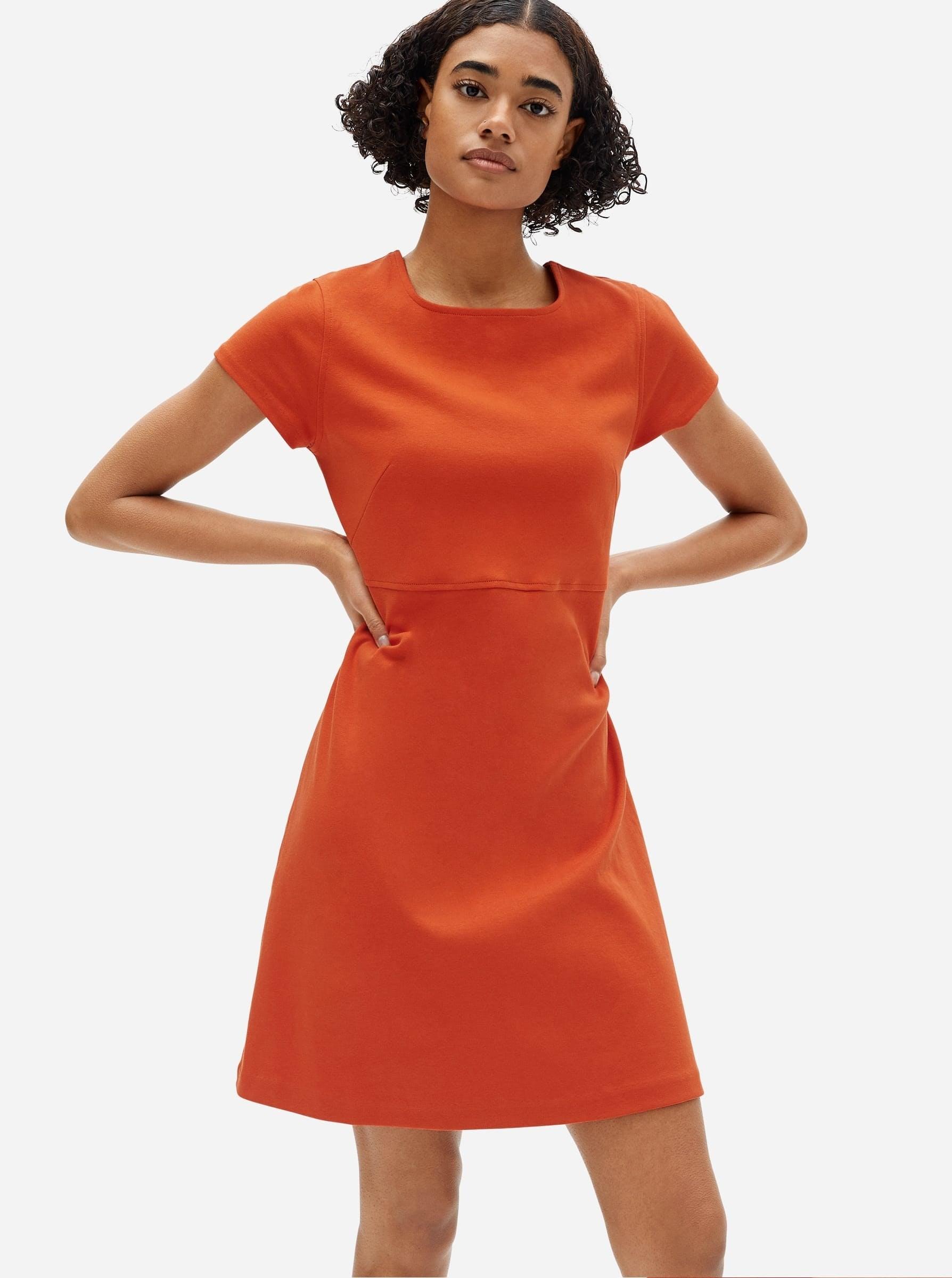 model in red short t-shirt dress
