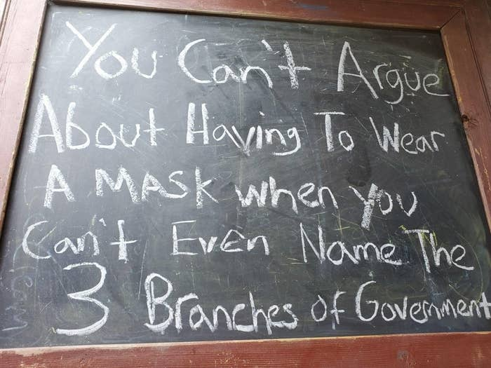 Sign reading you can't argue about having to wear a mask when you can't even name the 3 branches of government