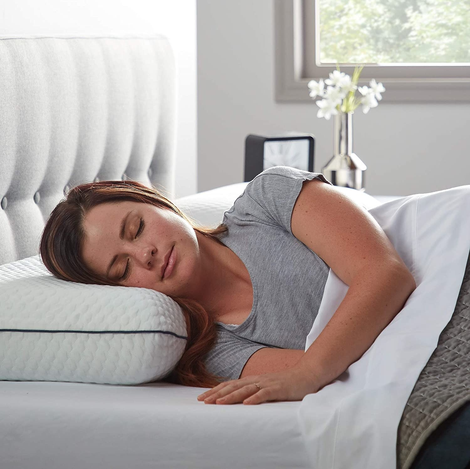 Model sleeping on their side with the pillow