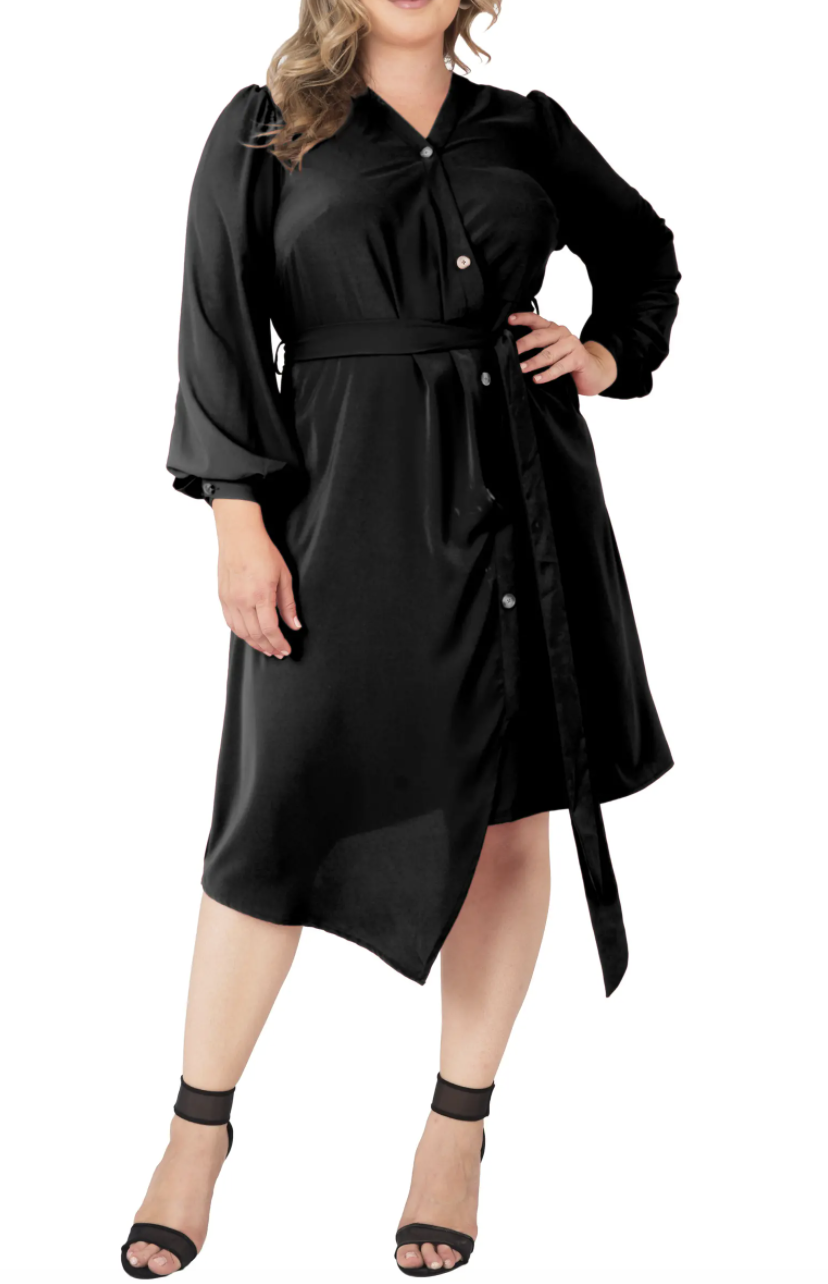 Model wearing the black shirtdress with balloon sleeves, buttons down the front, and tie waist