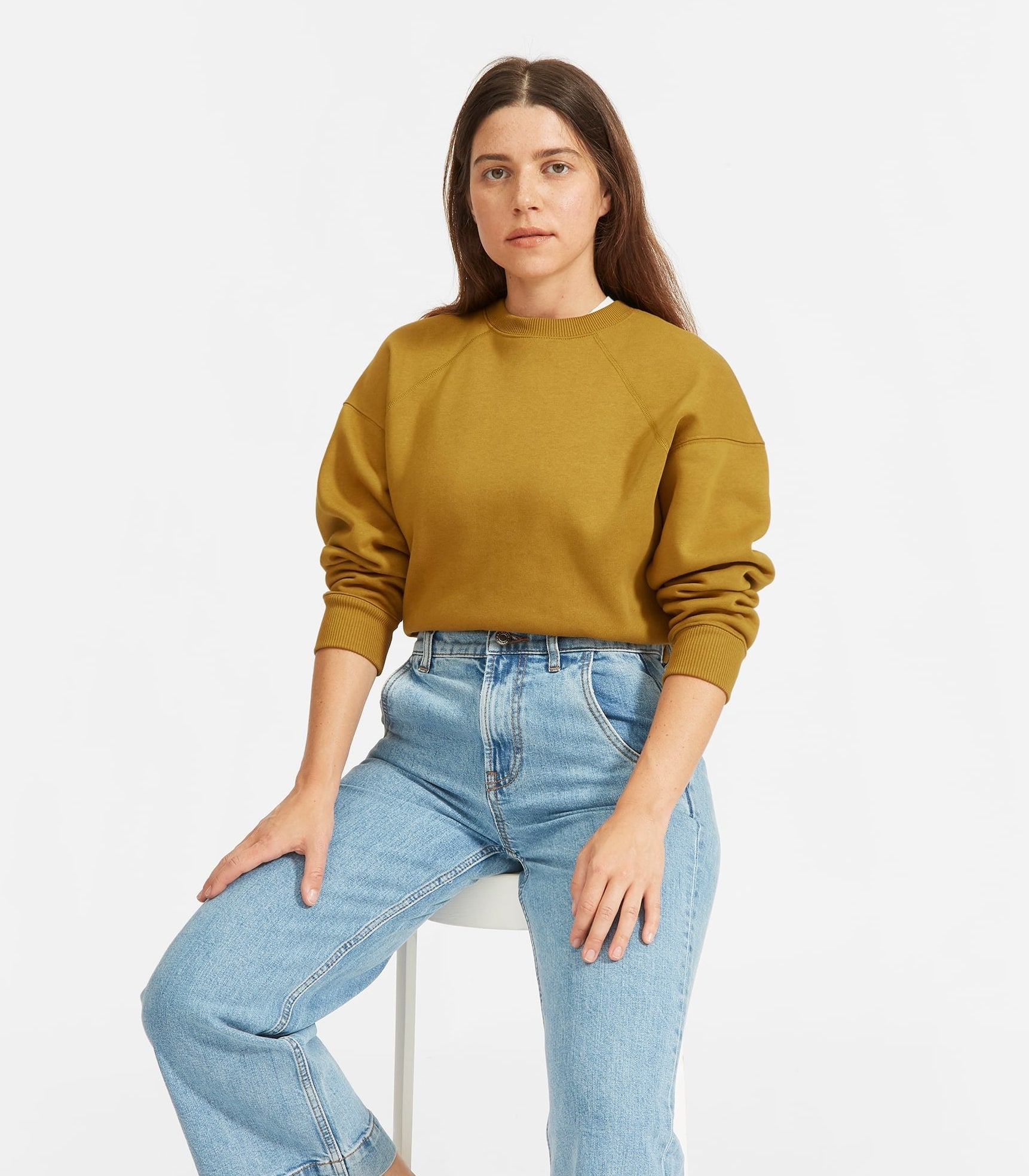 model in yellowish green sweatshirt