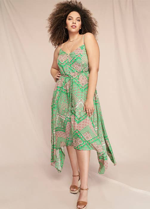 a model in a handkerchief print dress in green and pink
