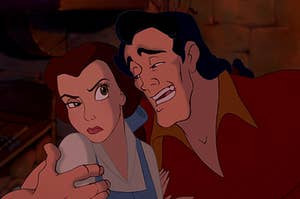 Gaston with his arm around Belle who is looking annoyed
