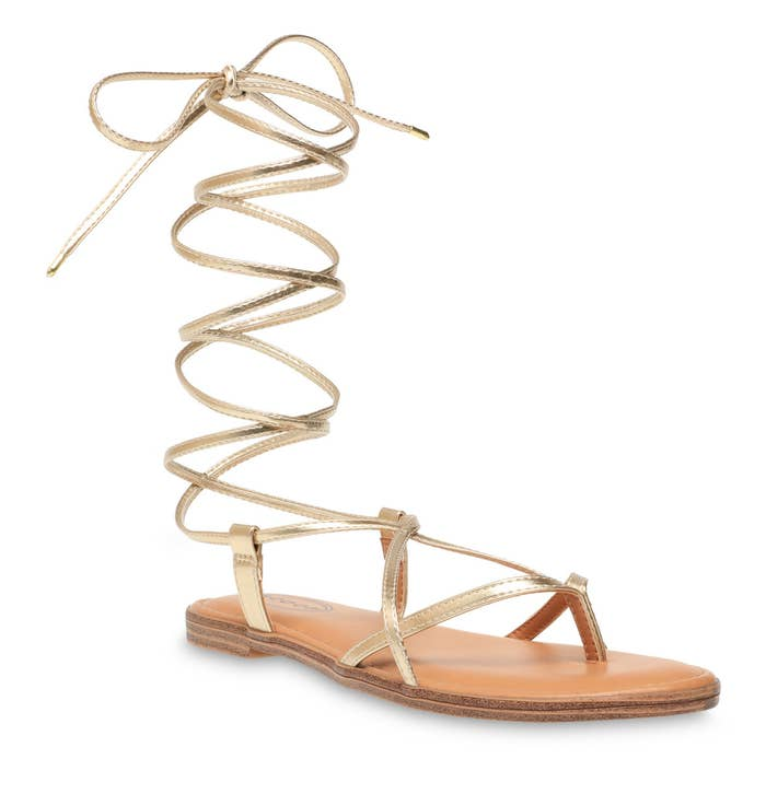 A light gold lace-up thong sandal