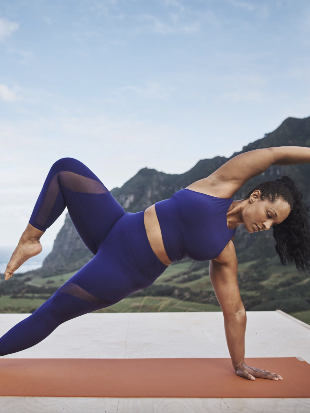 A model wearing the leggings while doing yoga poses