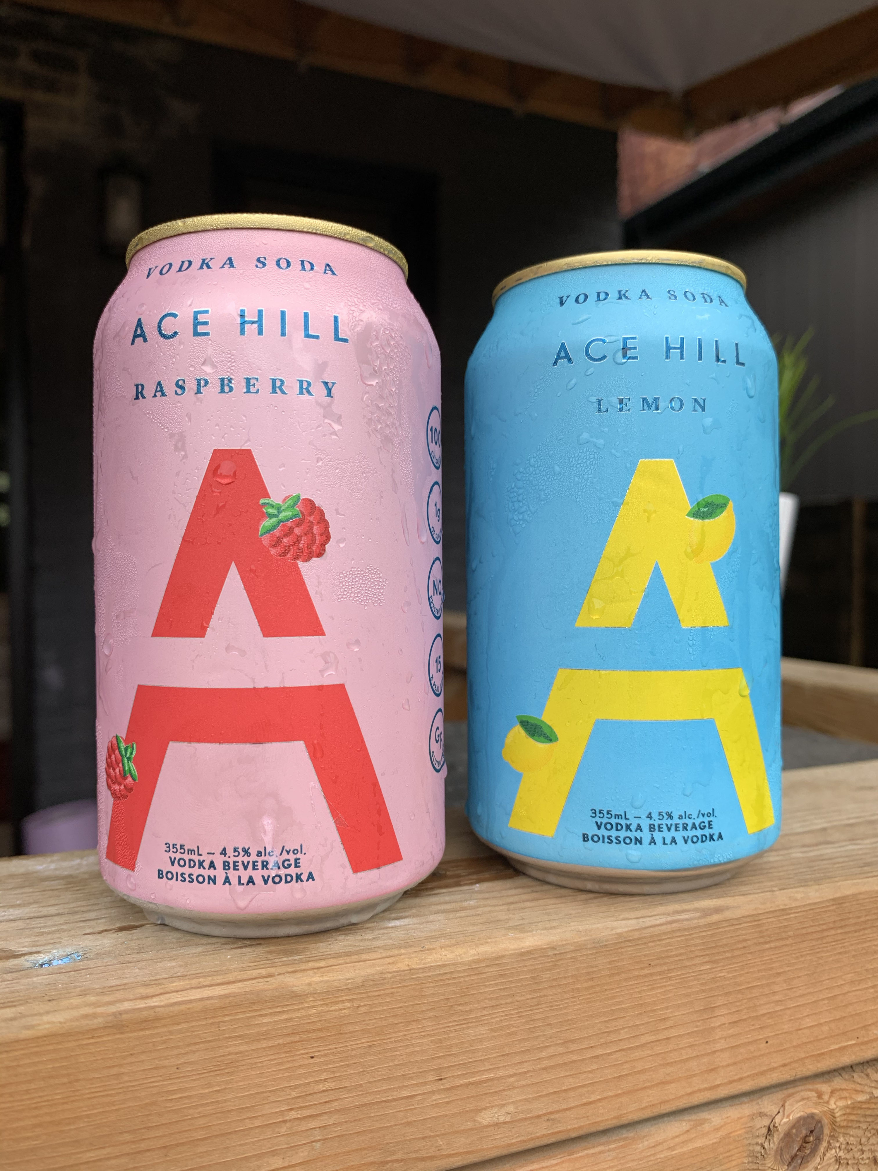 A can of Ace Hill Raspberry (pink can) and Ace Hill Lemon (blue can).