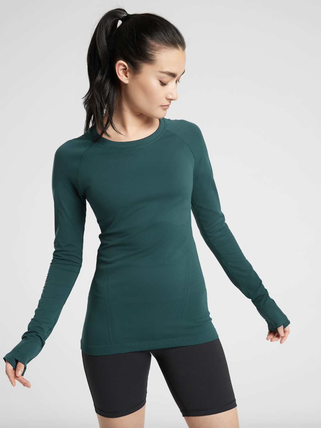 A model wearing the crew-neck top, which has thumb holes in the extra-long sleeves