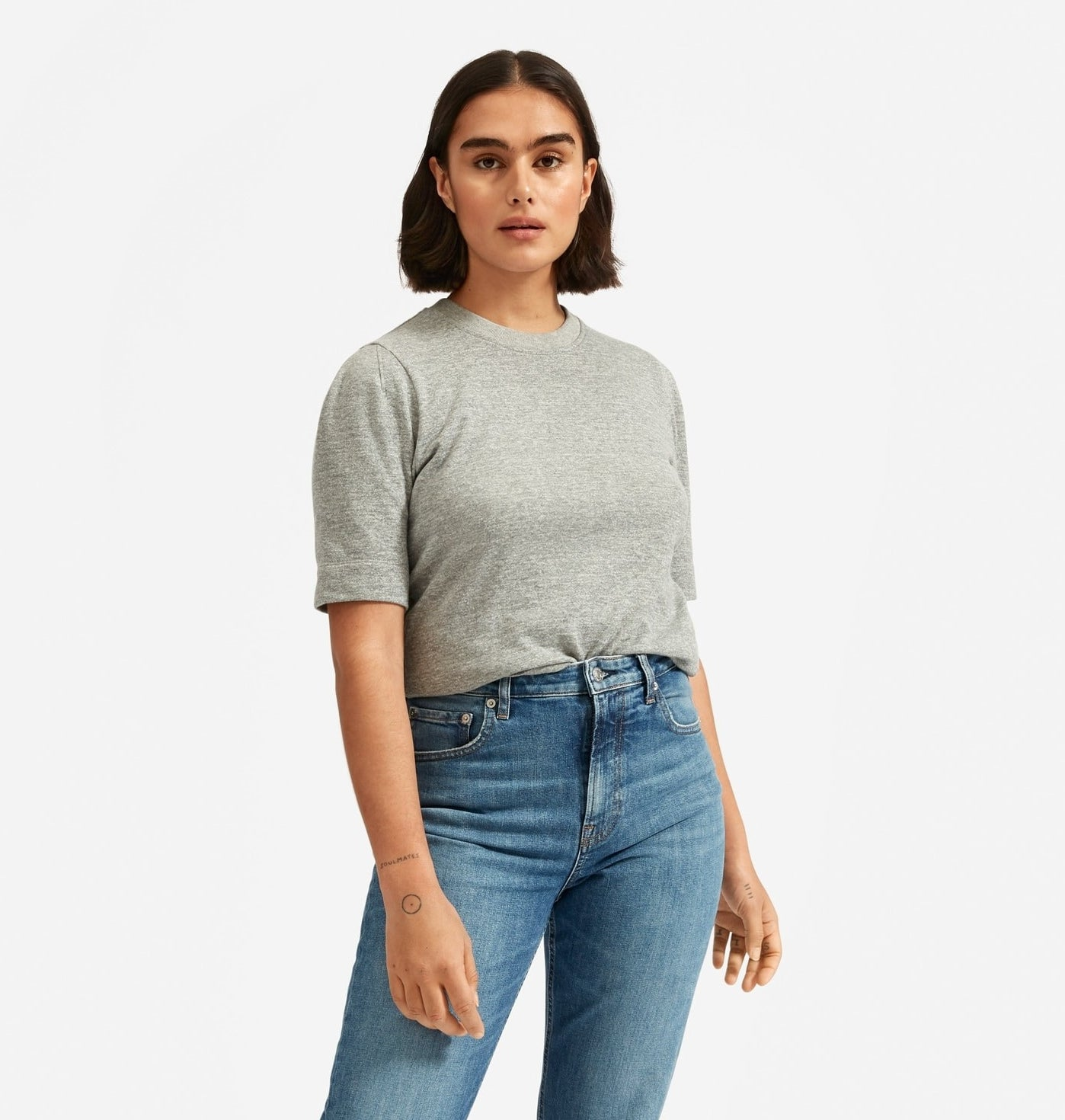 model in grey crewneck tee with almost elbow length sleeves