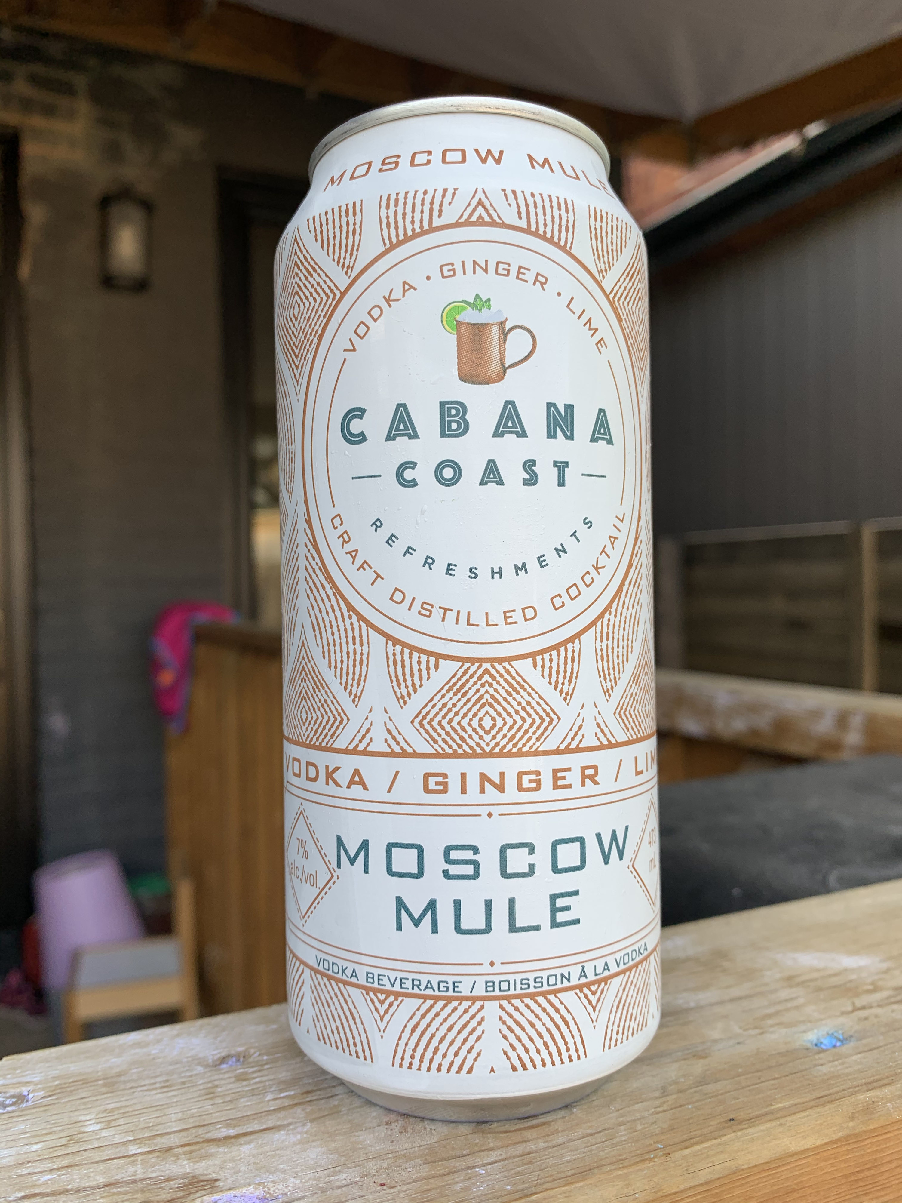 A can of Cabana Coast Moscow Mule that is in a gold and white can with an intricate gold pattern taking up most of the can.