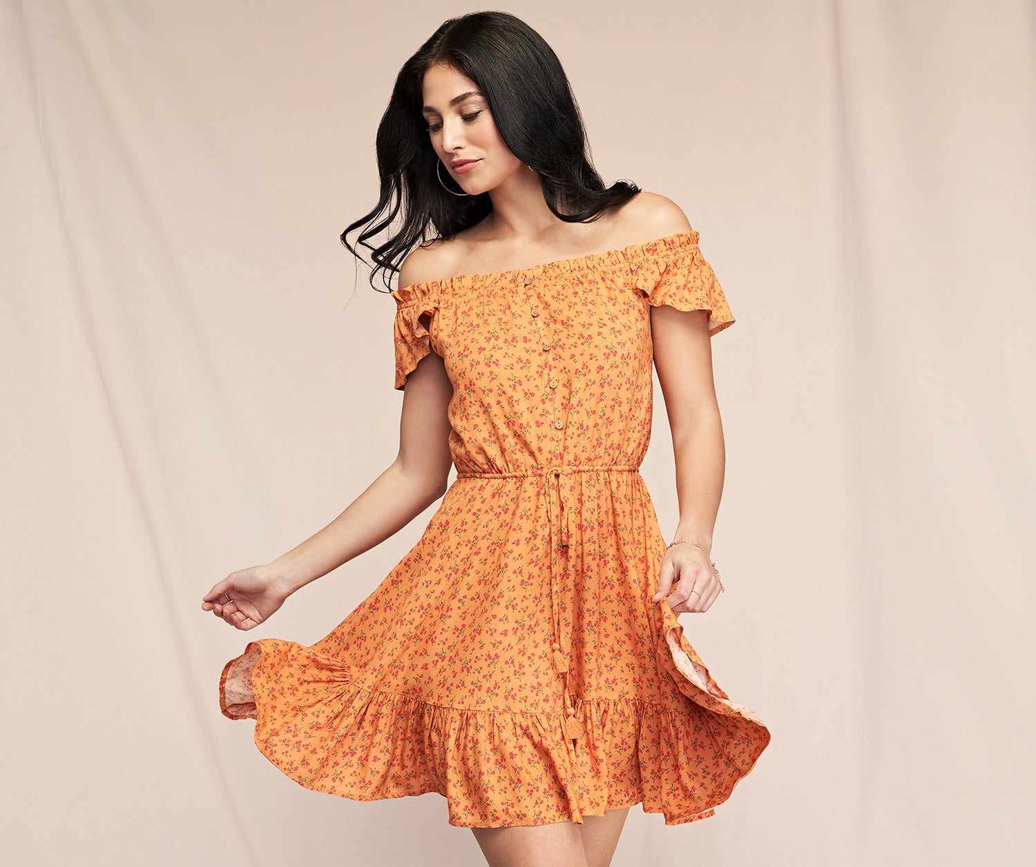 a model in the orange sun dress covered in tiny florals