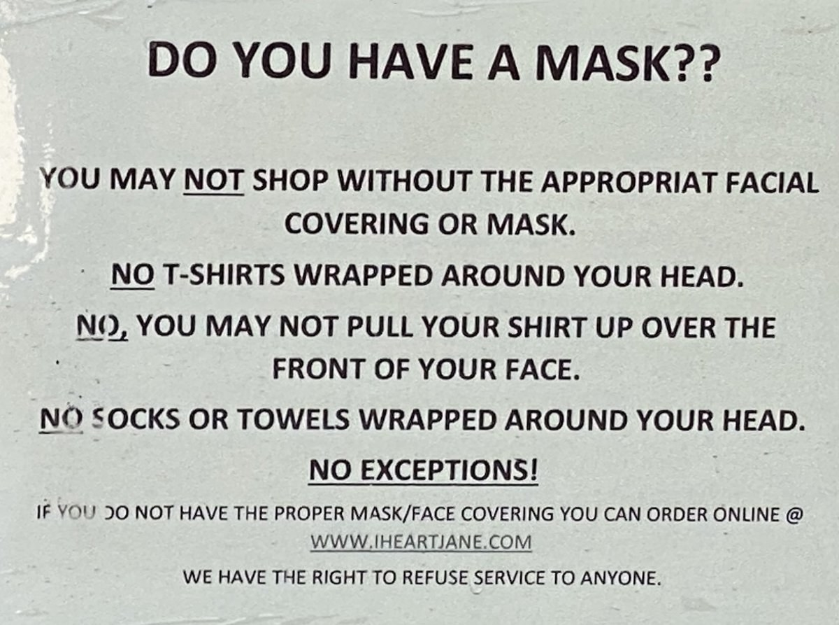 Sign about how shirts, towels, and socks are not proper masks