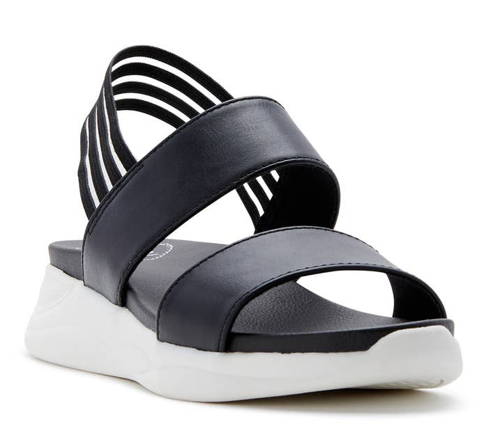 A chunky black sandal with a white sole
