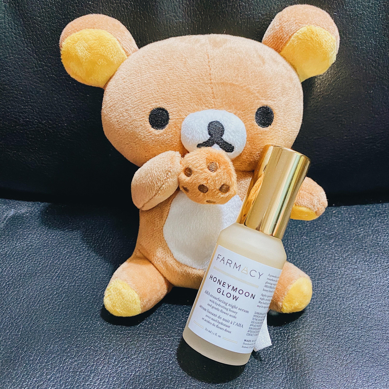 a cute teddy bear holding the tan bottle of honeymoon glow