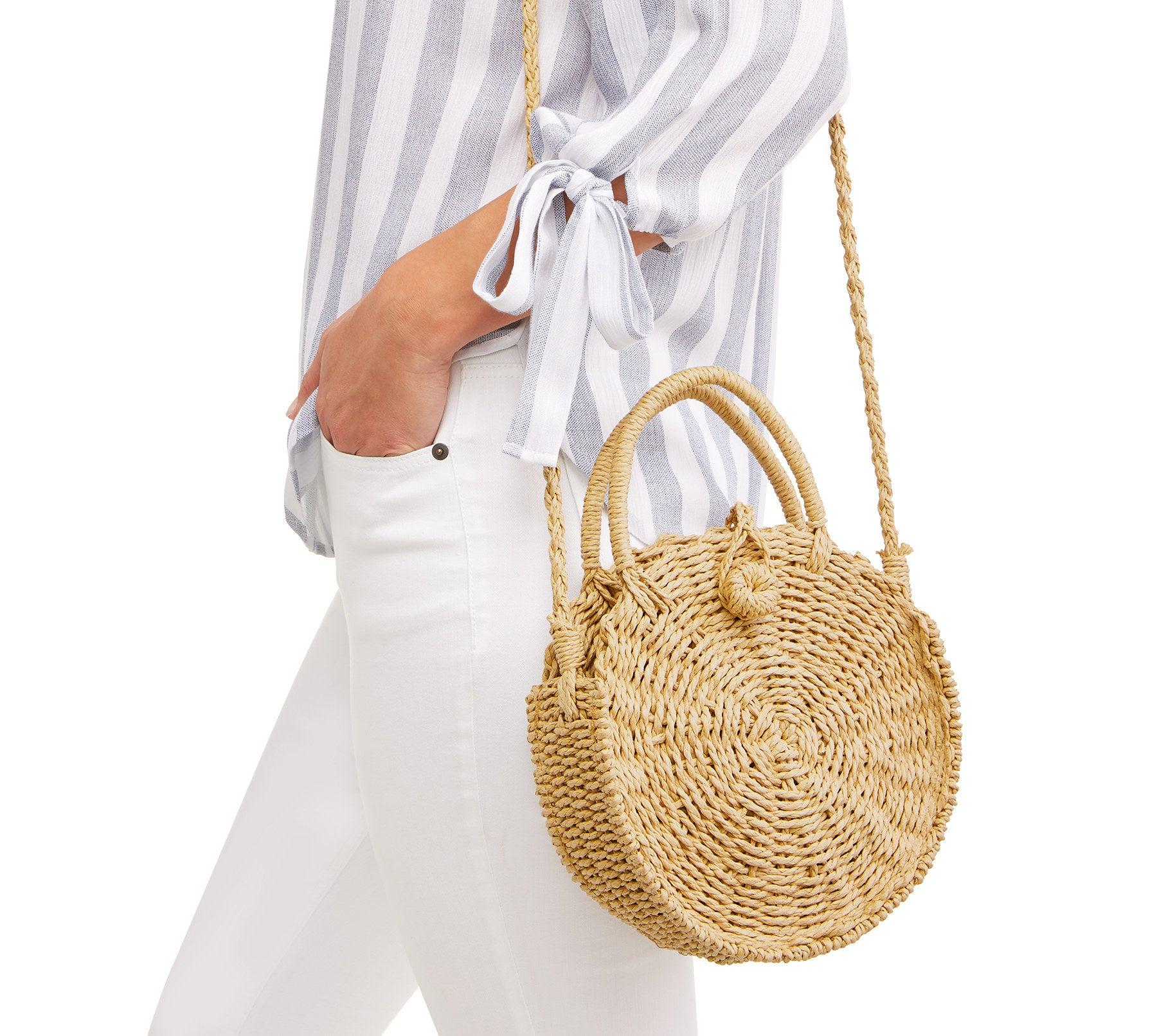 a model wearing the bag as a cross body