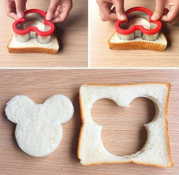 A person using the sandwich cutter