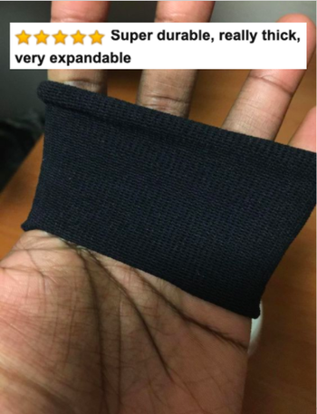 Hand stretching the thick hair tie with Amazon caption that it's super durable, really thick, and very expandable