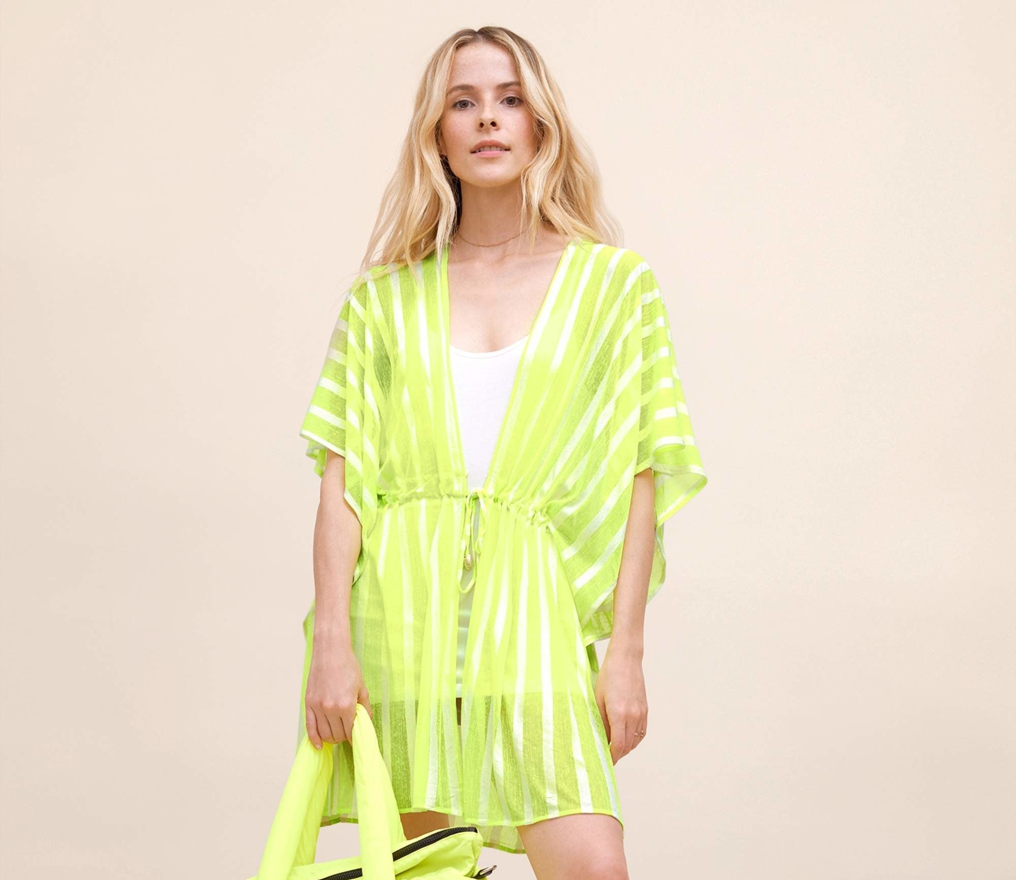 a model in a neon yellow cover up