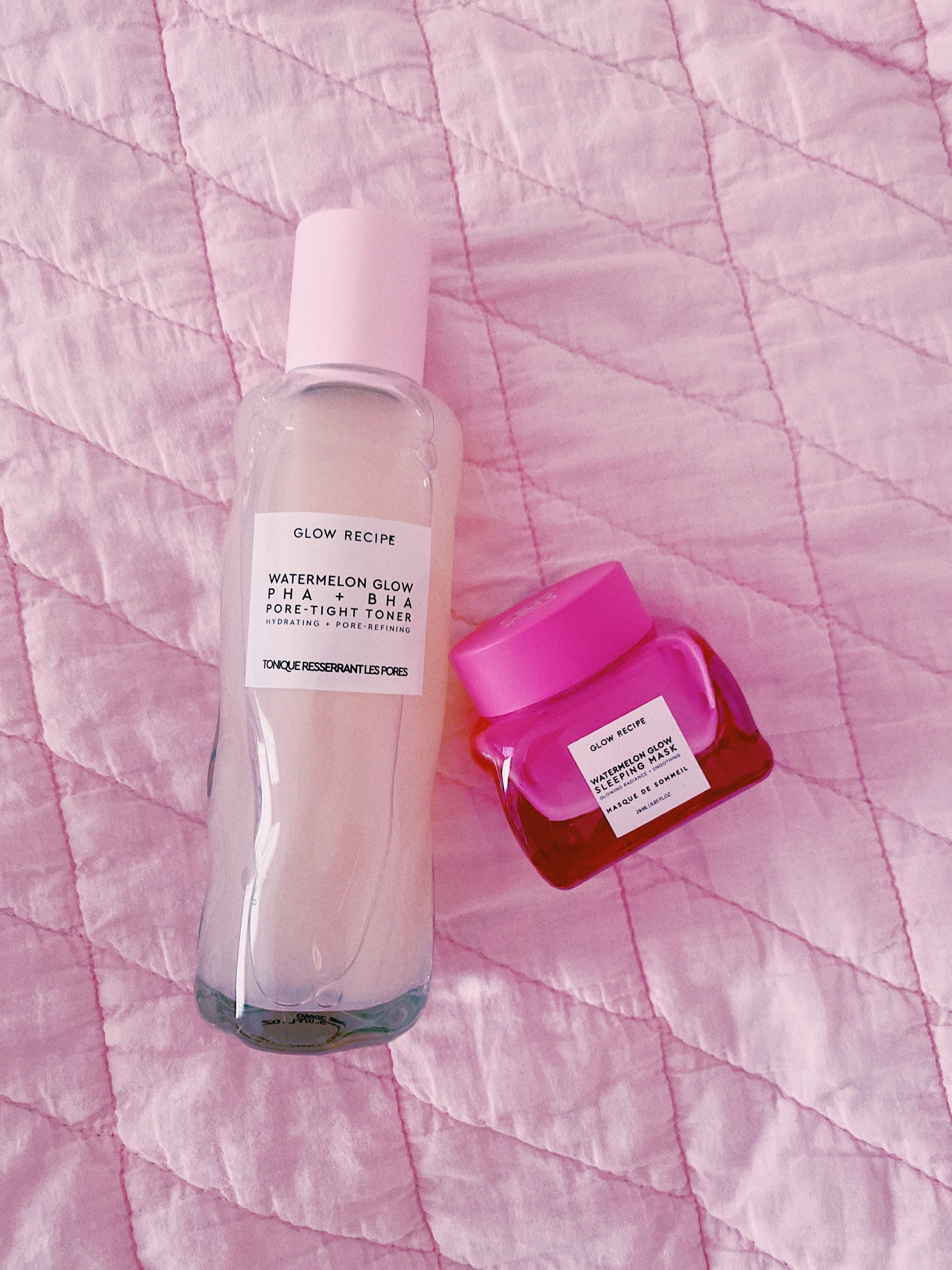 a pink glass bottle of the watermelon toner