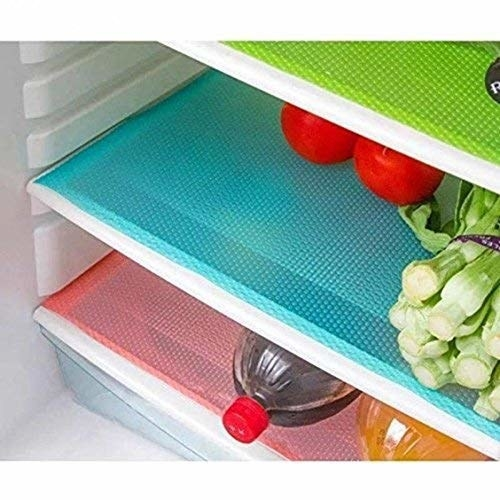The mats pictured inside a refrigerator.