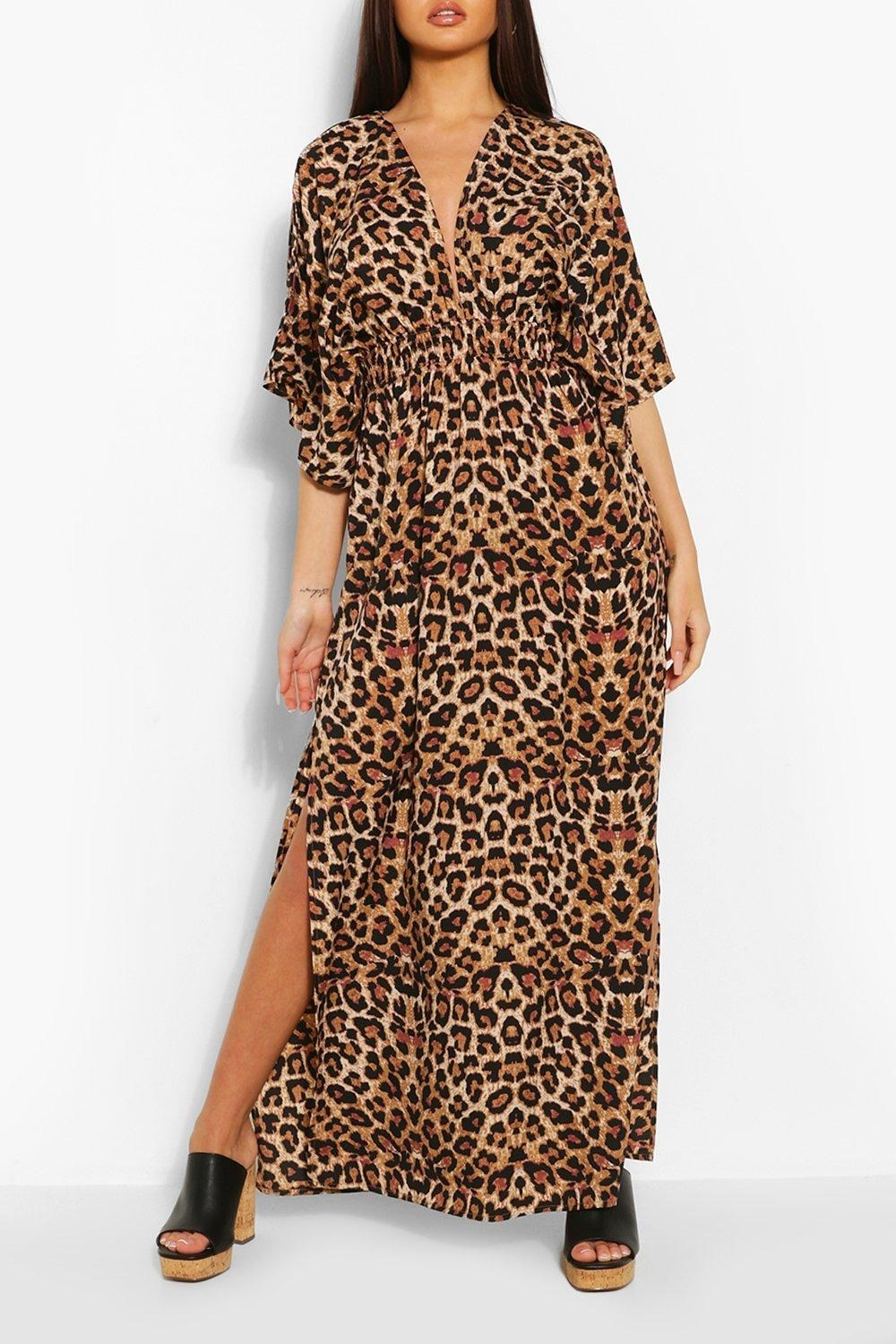model wearing cheetah print kimono style dress with V-neck, side slits that go to the knee