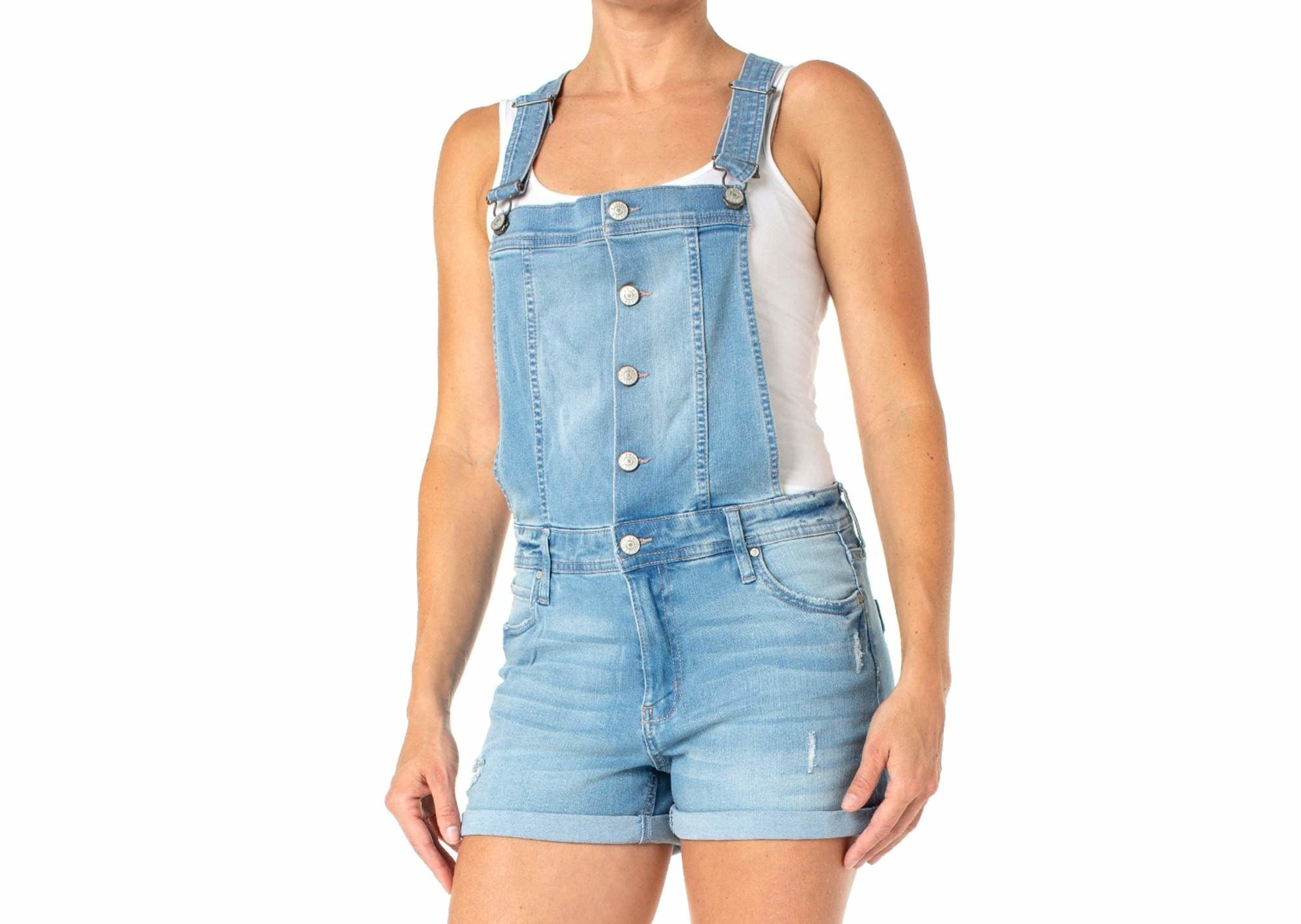 a model wearing the short denim overalls