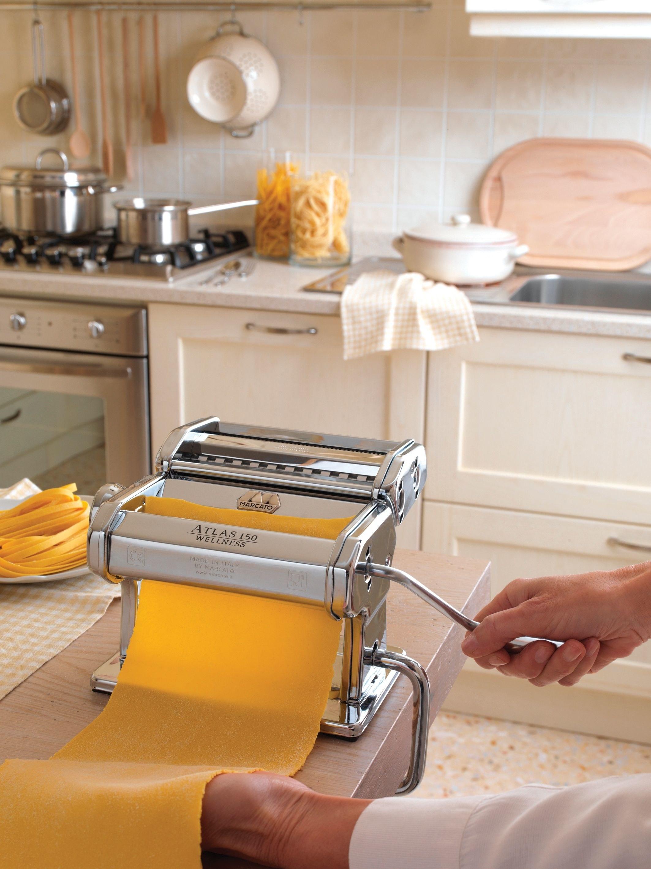 Hand churning pasta dough with pasta maker
