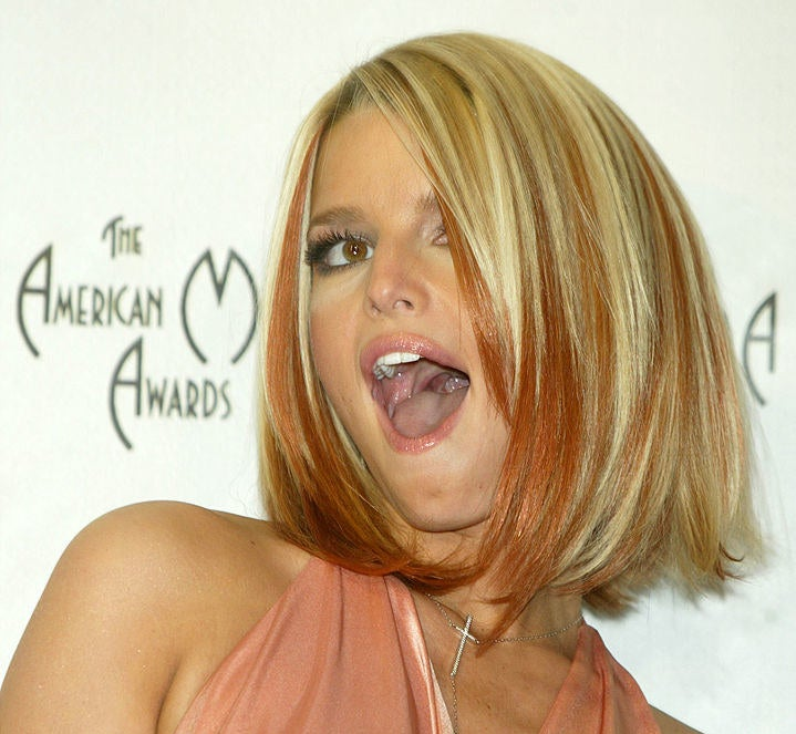 Jessica Simpson has short hairstyle of blonde highlights mixed in with orange pieces
