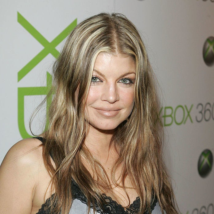 Fergie has wavy hair and light highlights