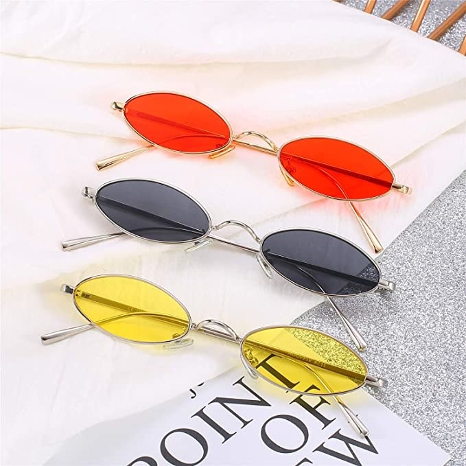 Three pairs of sunglasses on a table