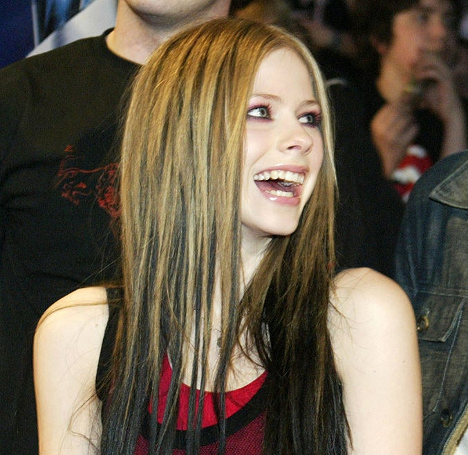 Avril has dark hair dyed underneath the rest of her hair that matches her signature rocker style