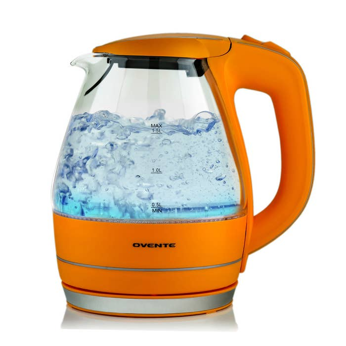 A glass kettle with orange plastic detailing