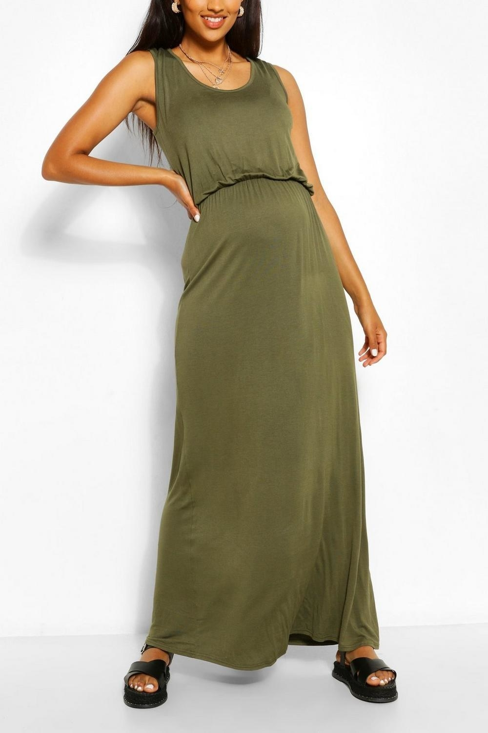 olive green ankle length strapless dress with scoop neck and shirred waist