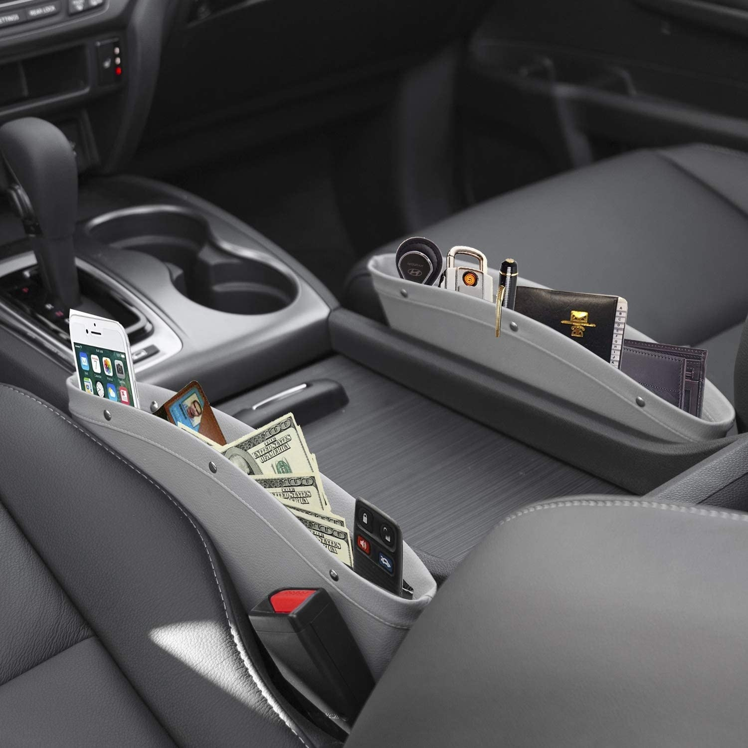 The car seat gap organizer holding a phone, cash, sunglasses, and more