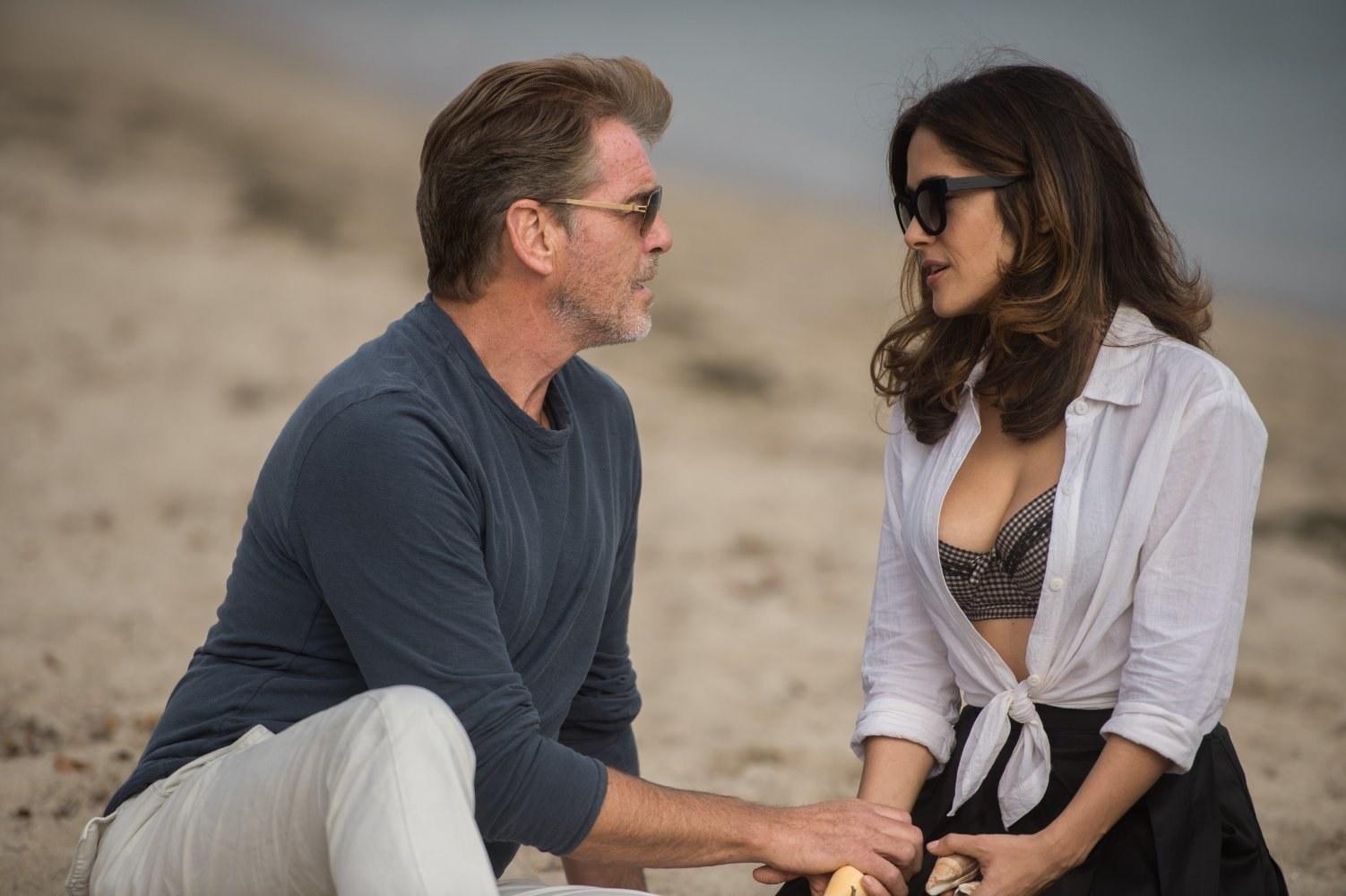 Pierce Brosnan and Salma Hayek talk on the beach in Some Kind of Beautiful