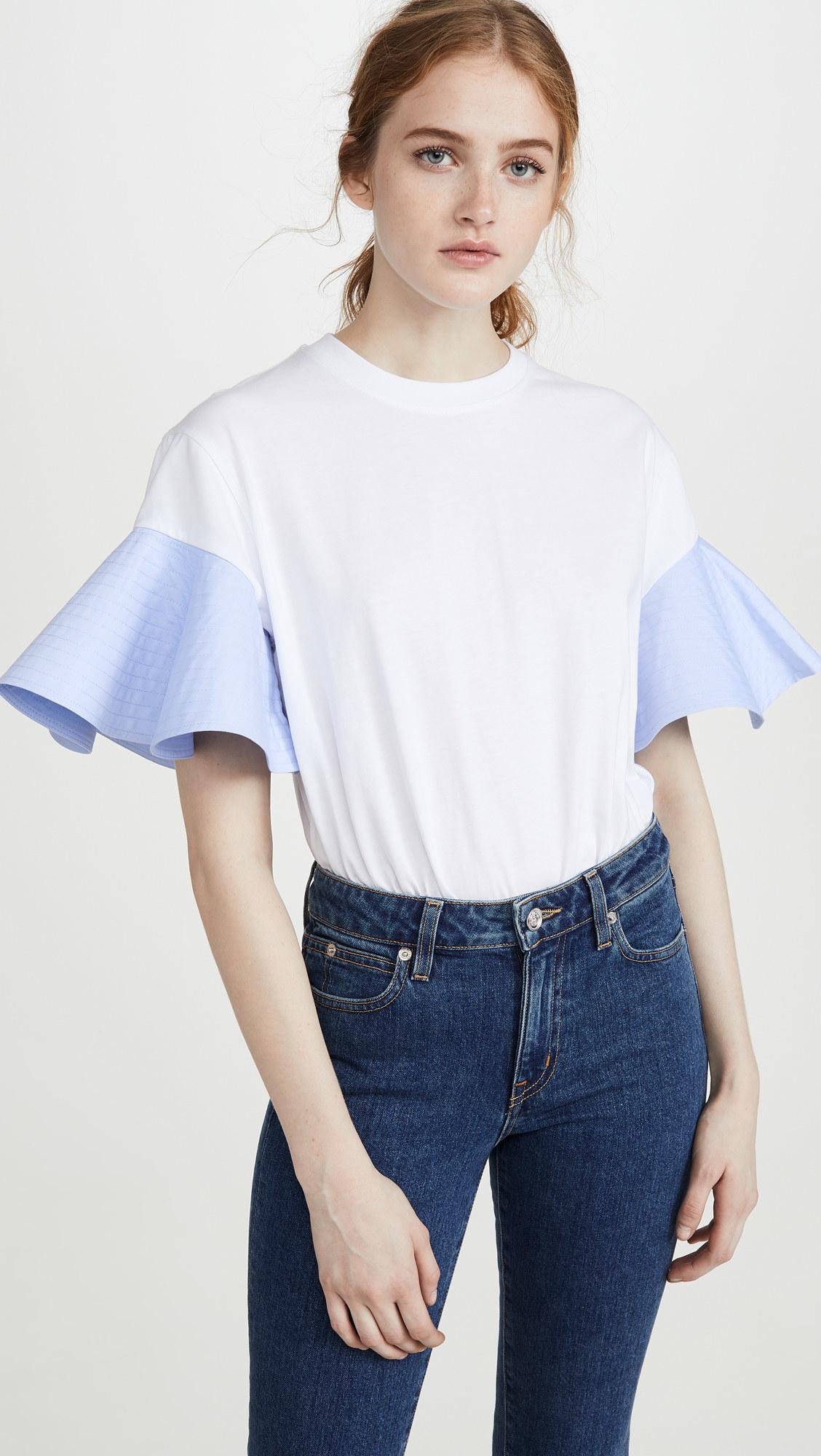 A model wearing the Victoria Victoria Beckham ruffle sleeve T-shirt.